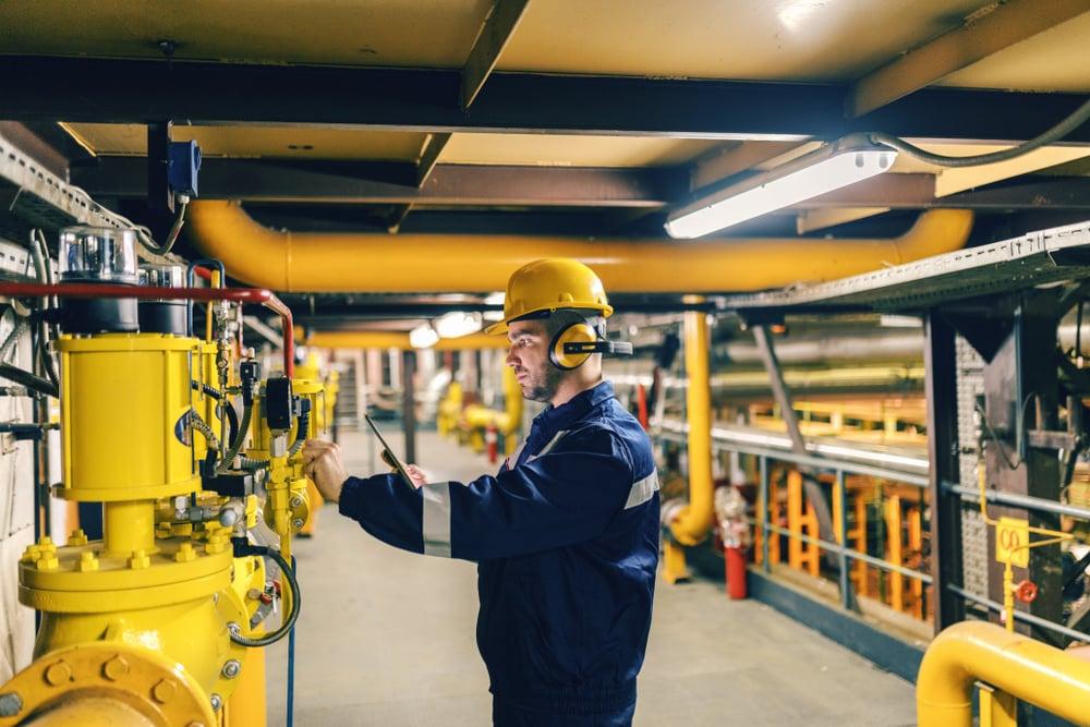 Mobile maintenance worker assessing equipment