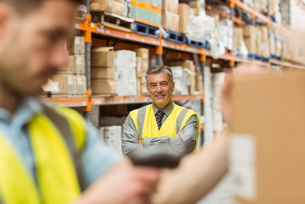 Warehouse worker scanning barcode for inventory accuracy